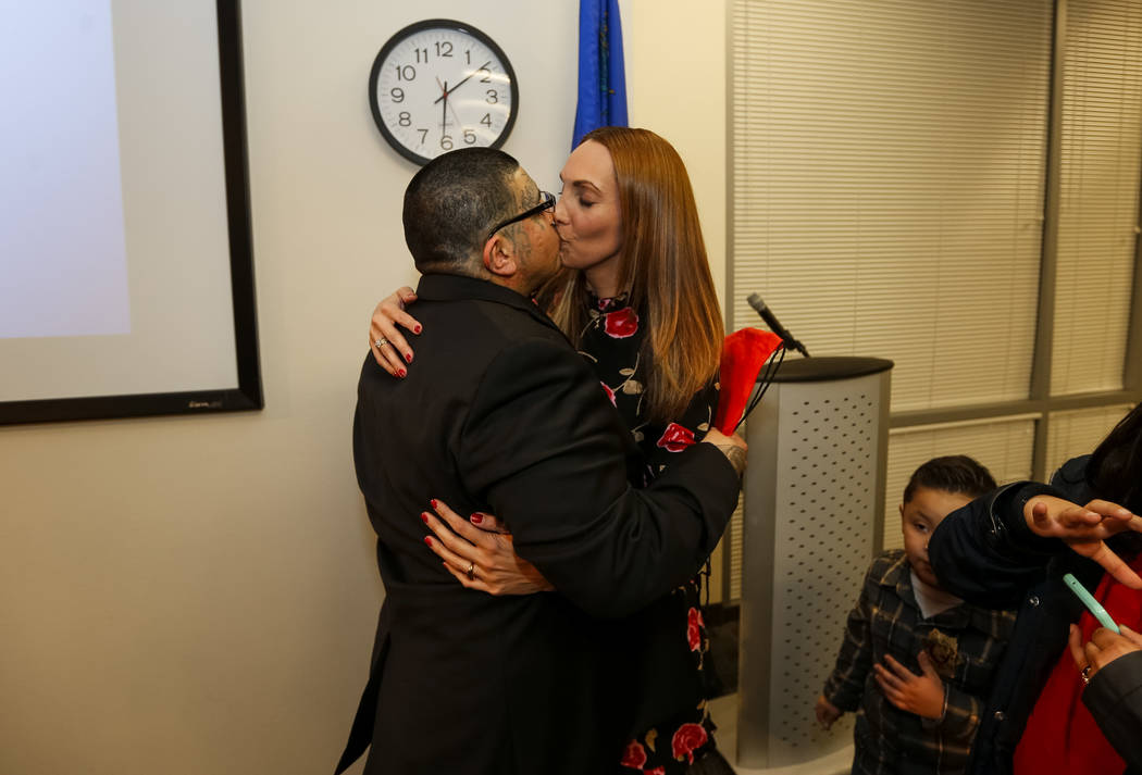 Attorney Alexis Plunkett and her boyfriend Andrew Arevalo share a kiss following the Hope for Prisoners graduation ceremony at the Las Vegas Metropolitan Police Headquarters in Las Vegas on Friday ...