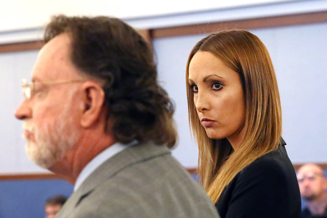 Alexis Plunkett, a criminal defense attorney facing a dozen felony charges for providing a cell phone to inmates at the Clark County Detention Center, appears in court with her attorney Robert Lan ...