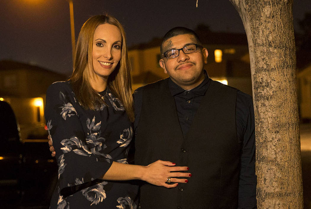 Attorney Alexis Plunkett, left, and her boyfriend Andrew Arevalo, a former gang member, pose at their house in Las Vegas on Thursday, Feb. 22, 2018. Richard Brian Las Vegas Review-Journal @vegasph ...