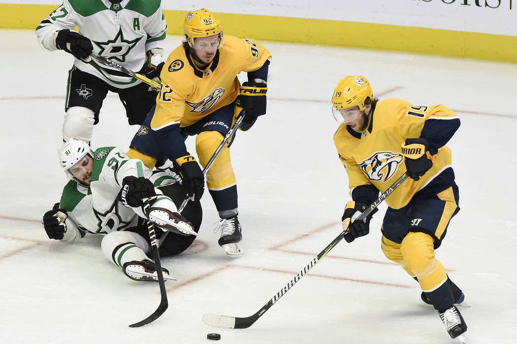 Nashville Predators center Calle Jarnkrok (19), of Sweden, gets control of the puck after stealing it away from Dallas Stars center Tyler Seguin (91) during the first period of an NHL hockey game ...