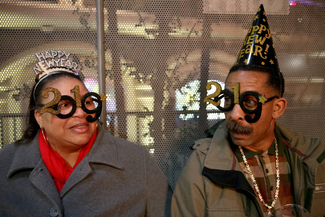 Kathleen McKinney and her fiancee Terrence Wilkins, both 55 of Los Angeles, wait for the fireworks on the Strip on New Year's Eve in Las Vegas Monday, Dec. 31, 2018. K.M. Cannon Las Vegas Review-J ...