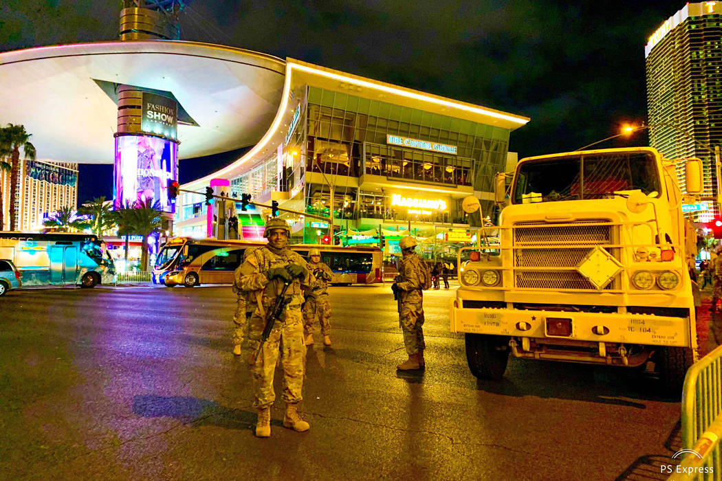 Members of the Nevada National Guard stand watch in front of the Fashion Show mall on Las Vegas Boulevard on Dec. 31, 2018. (Mick Akers/Las Vegas Review-Journal)