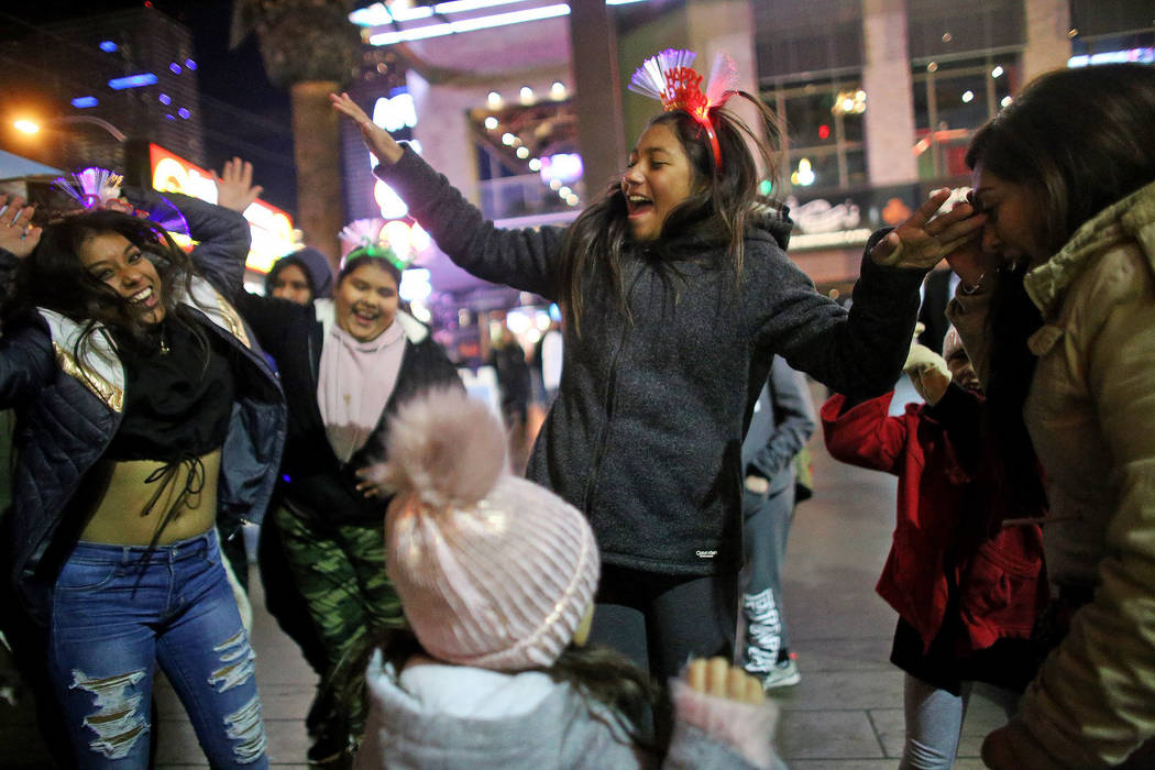 The Gomez and Resendiz family from Orange County dance on the Las Vegas Strip on Dec. 31, 2018. (Rachel Aston/Las Vegas Review-Journal)