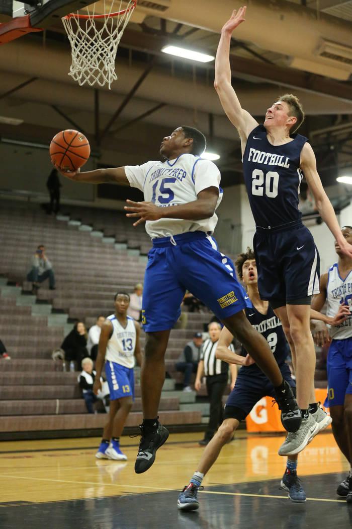 Trinity's Milton Burnett (15) jumps for a shot under pressure from Foothill's Caleb Stearman (20) in the Las Vegas Prep Championship seminal game at Las Vegas High School in Las Vegas, Friday, Dec ...