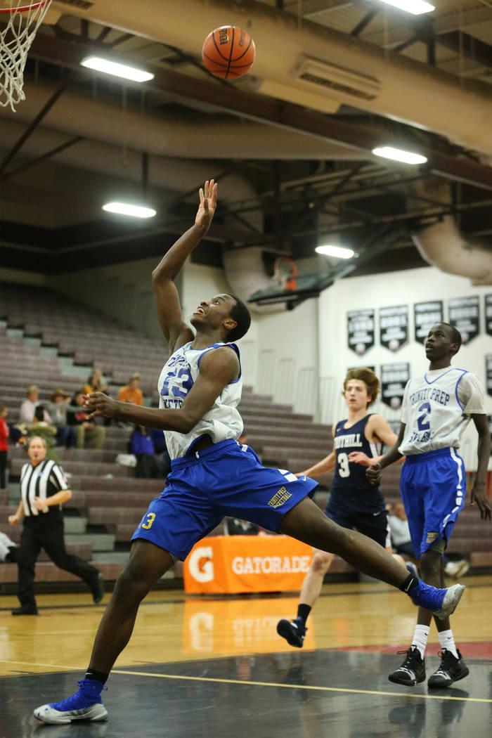 Trinity's Zaba Bangala (13) shoots the ball against Foothill in the Las Vegas Prep Championship seminal game at Las Vegas High School in Las Vegas, Friday, Dec. 28, 2018. Trinity won 80-61. Erik V ...