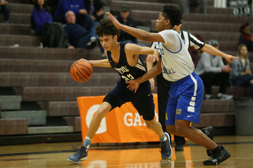 Foothill's Jace Rocequemore (22) drives the ball under pressure from Trinity's Jose Cuello (4) in the Las Vegas Prep Championship seminal game at Las Vegas High School in Las Vegas, Friday, Dec. 2 ...