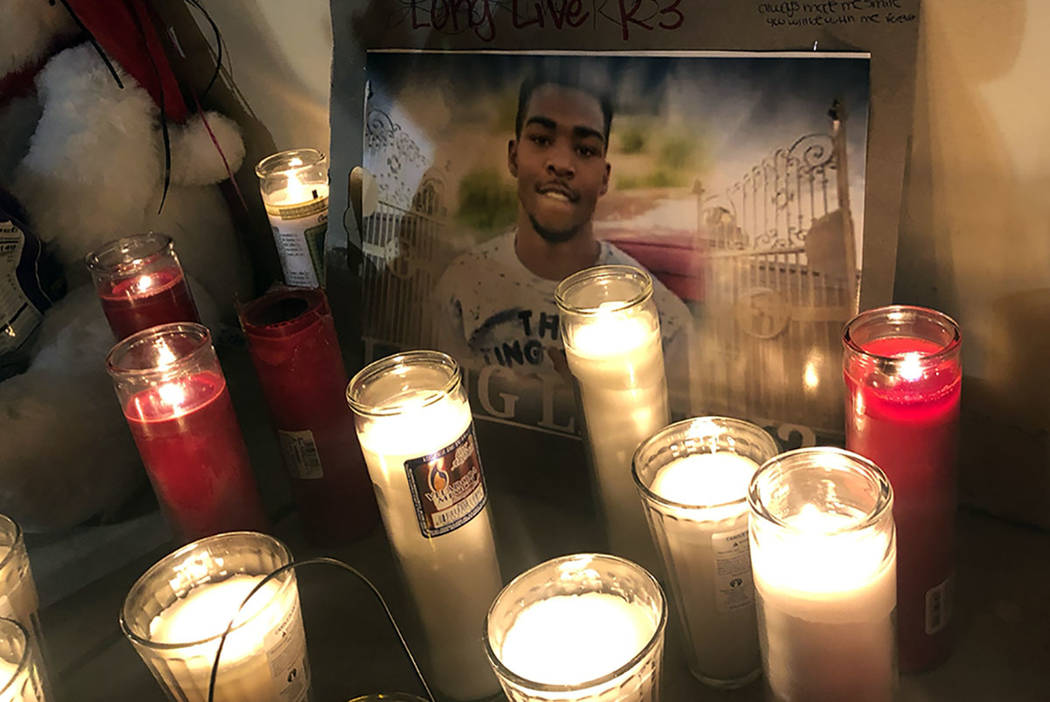 A picture of 18-year-old Kwavon'tia Thomas surrounded by candles during a vigil on Friday, December 28, 2018, where he was shot Christmas Eve in a parking lot near East Lake Mead Boulevard and McD ...