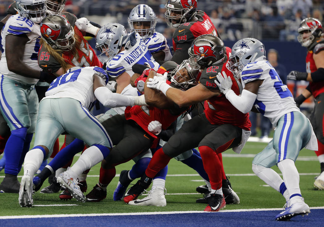 Tampa Bay Buccaneers running back Jacquizz Rodgers (32) is helped into the end zone for a touchdown by tight end Antony Auclair (82) as Dallas Cowboys defensive end DeMarcus Lawrence (90) and Xavi ...