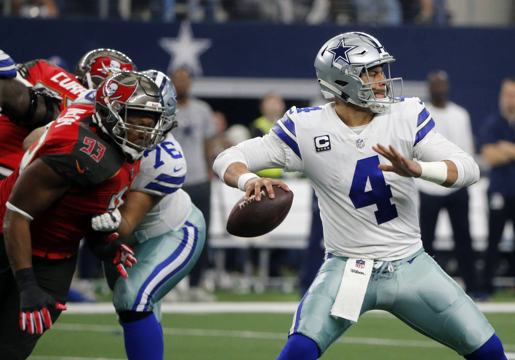 Tampa Bay Buccaneers defensive tackle Gerald McCoy (93) rushes as Dallas Cowboys quarterback Dak Prescott (4) prepares to throw a pass in the second half of an NFL football game in Arlington, Texa ...