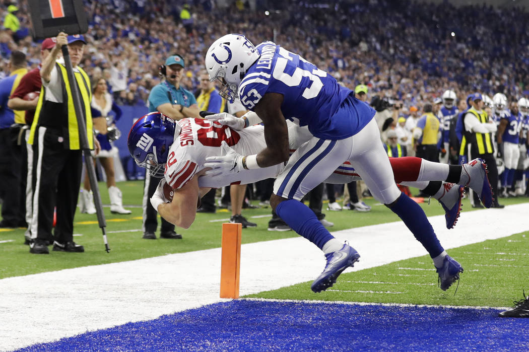 New York Giants tight end Scott Simonson (82) dives in for a touchdown under Indianapolis Colts outside linebacker Darius Leonard (53) during the first half of an NFL football game in Indianapolis ...