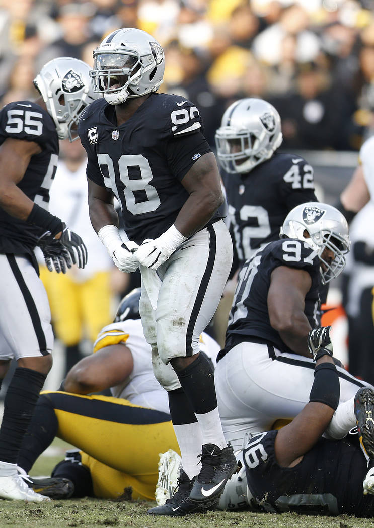Oakland Raiders defensive tackle Frostee Rucker (98) reacts during an NFL football game against the Pittsburgh Steelers in Oakland, Calif., Sunday, Dec. 9, 2018. (AP Photo/D. Ross Cameron)