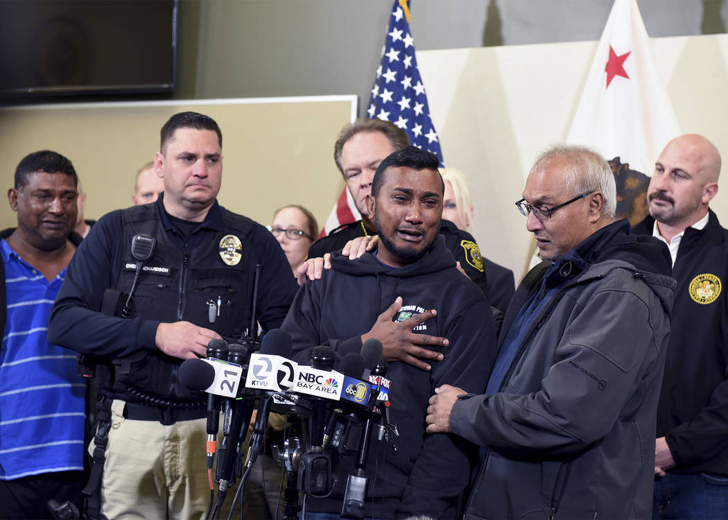 Reggie Singh, brother of Newman Police officer Ronil Singh is overcome with emotion as he thanks law enforcement after the arrest of suspect Gustavo Perez Arriaga and others Friday, Dec. 28, 2018 ...