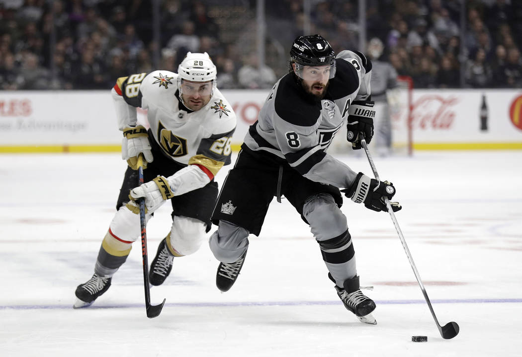 Los Angeles Kings' Drew Doughty (8) is defended by Vegas Golden Knights' William Carrier during the second period of an NHL hockey game Saturday, Dec. 29, 2018, in Los Angeles. (AP Photo/Marcio Jo ...