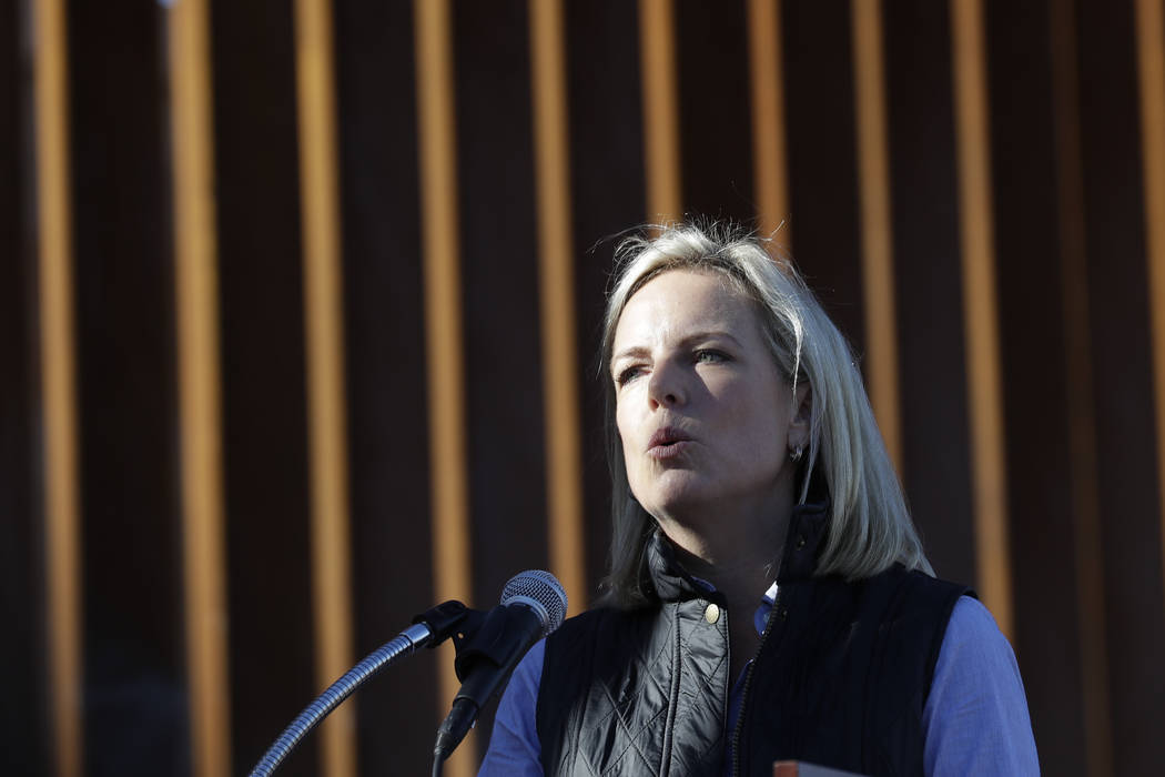 In this Oct. 26, 2018, file photo U.S. Department of Homeland Security Secretary Kirstjen Nielsen speaks in front of a newly fortified border wall structure in Calexico, Calif. (AP Photo/Gregory Bull)