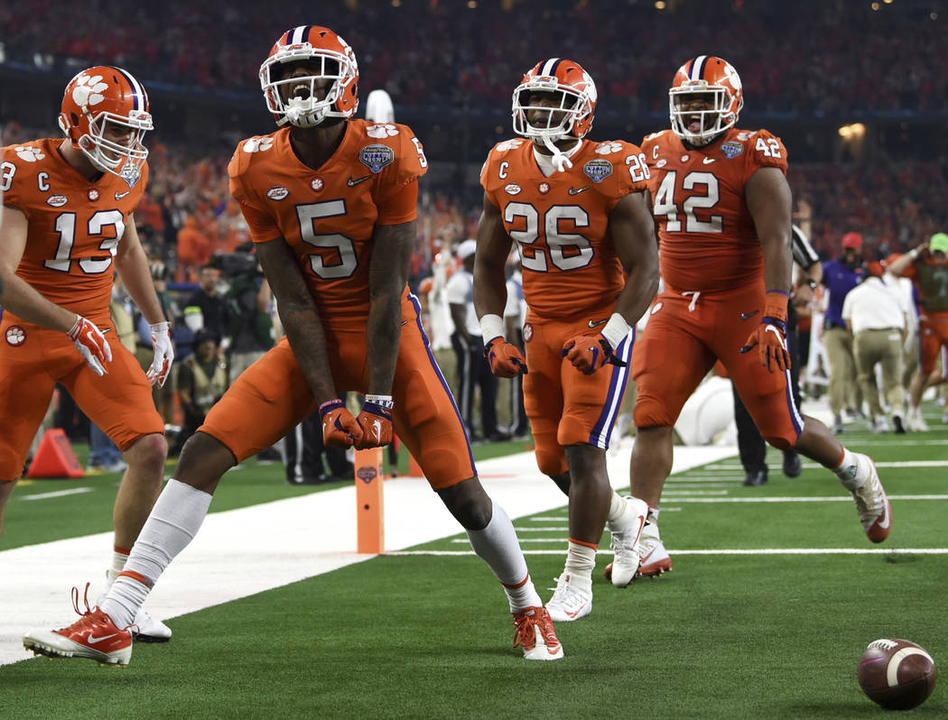 Clemson wide receiver Tee Higgins (5) celebrates his touchdown catch with wide receiver Hunter Renfrow (13), running back Adam Choice (26) and linebacker John Boyd (46) in the first half of the NC ...
