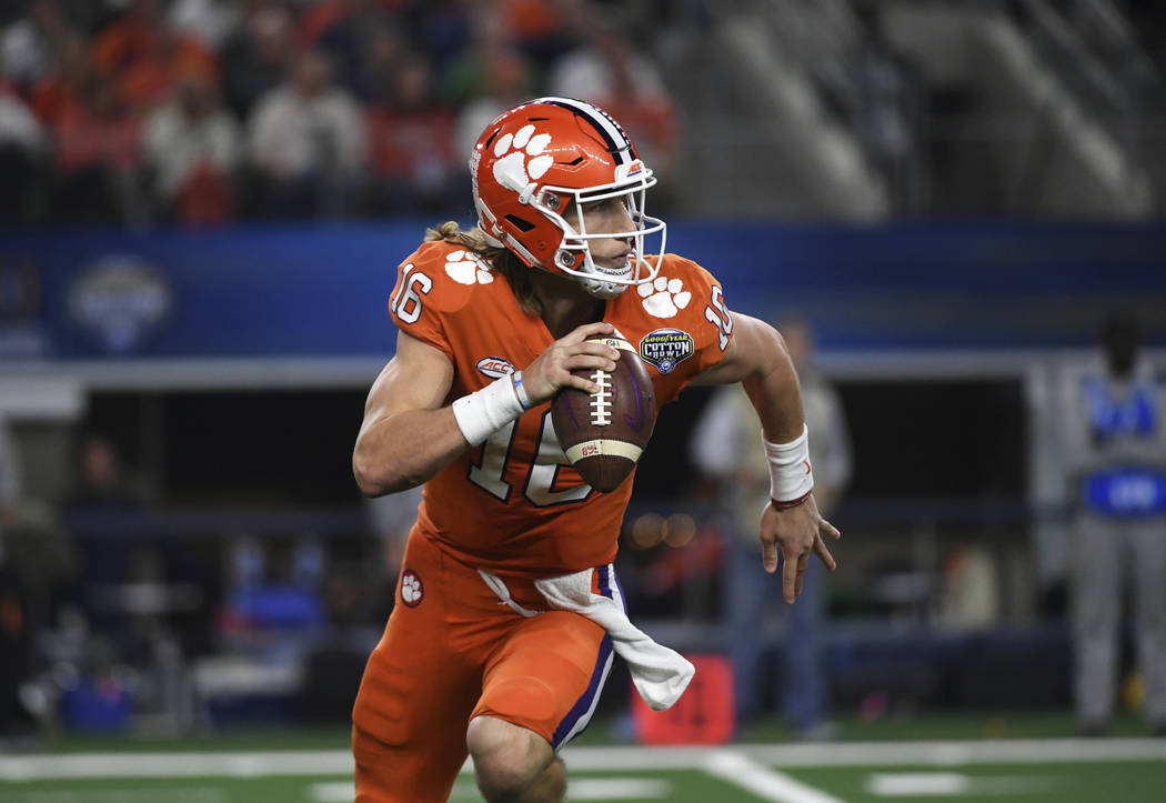 Clemson quarterback Trevor Lawrence (16) scrambles out of the pocket in the second half of the NCAA Cotton Bowl semi-final playoff football game against Notre Dame on Saturday, Dec. 29, 2018, in A ...