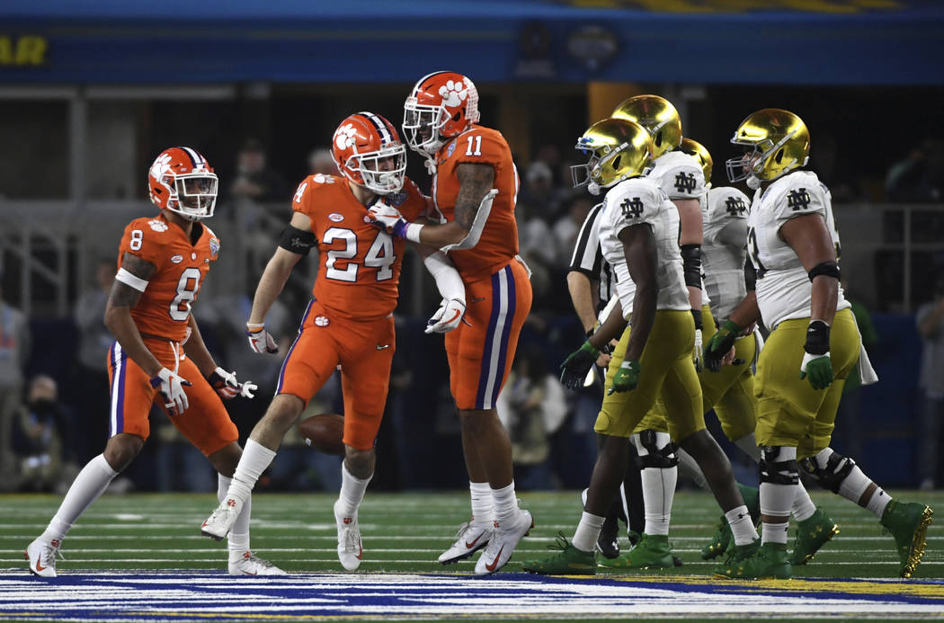 Clemson cornerback A.J. Terrell (8), safety Nolan Turner (24) and safety Isaiah Simmons (11) celebrate a interception thrown by Notre Dame quarterback Ian Book (12) in the second half of the NCAA ...