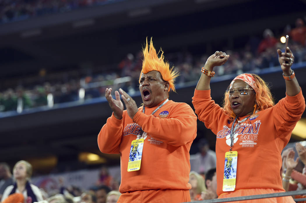 Clemson fans cheer on their team in the second half of the NCAA Cotton Bowl semi-final playoff football game against Notre Dame on Saturday, Dec. 29, 2018, in Arlington, Texas. (AP Photo/Jeffrey M ...