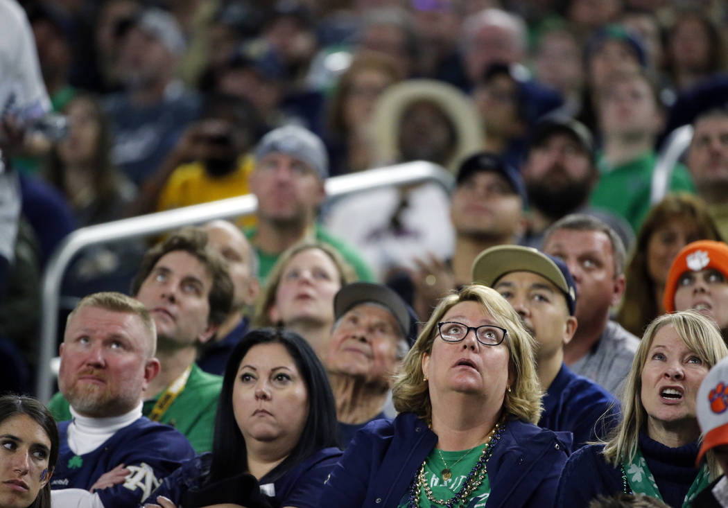 Notre Dame fans watch play against Clemson in the second half of the NCAA Cotton Bowl semi-final playoff football game, Saturday, Dec. 29, 2018, in Arlington, Texas. (AP Photo/Michael Ainsworth)