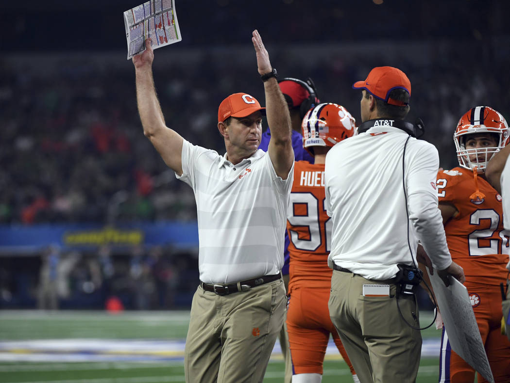 Clemson head coach Dabo Swinney signals to his team in the first half of the NCAA Cotton Bowl semi-final playoff football game against Notre Dame on Saturday, Dec. 29, 2018, in Arlington, Texas. ( ...