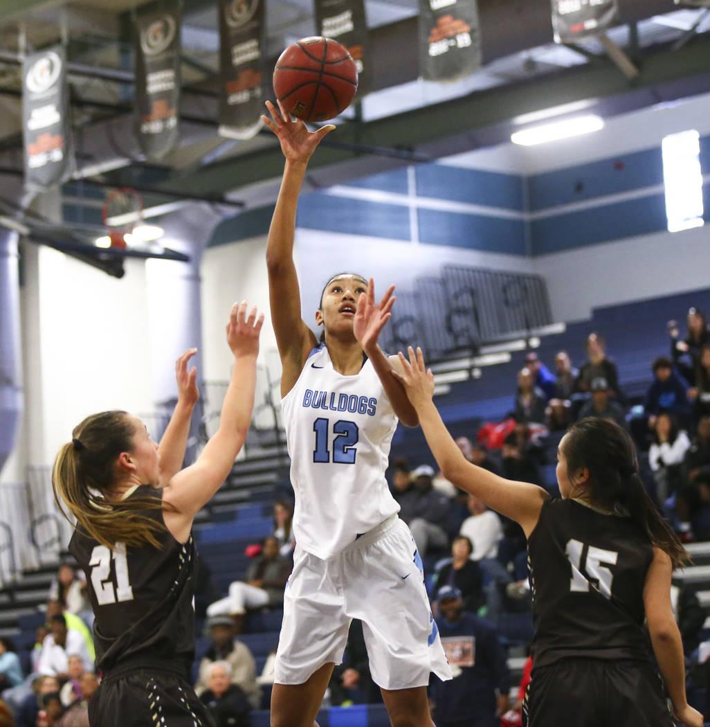 CentennialÕs Aishah Brown (12) shoots between WestÕs Ella Estabrook (21) and WestÕs Rachel Arakawa (15) during a basketball game at Centennial High School in Las Vegas on Saturday, ...