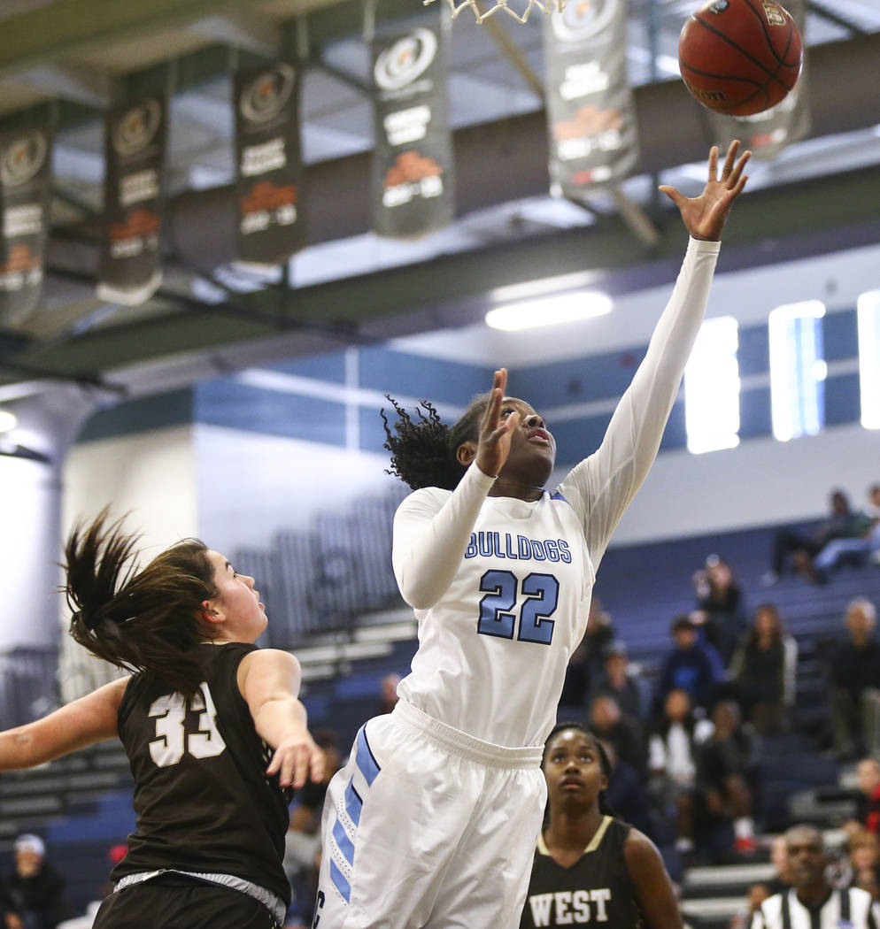CentennialÕs Eboni Walker (22) goes to the basket past WestÕs Piper Takenaka (33) during a basketball game at Centennial High School in Las Vegas on Saturday, Dec. 29, 2018. Chase Steven ...