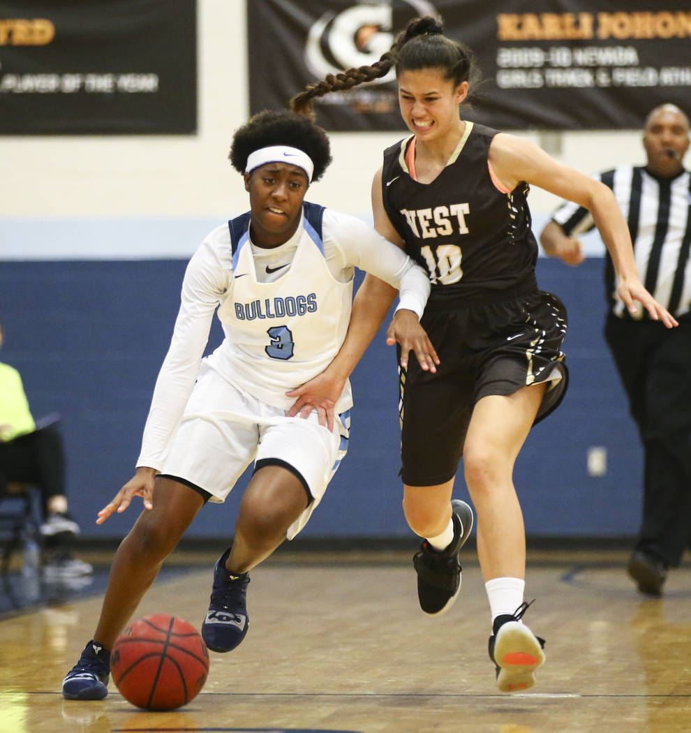 CentennialÕs Quinece Hatcher (3) drives the ball under pressure from WestÕs Christina Swenson (10) during a basketball game at Centennial High School in Las Vegas on Saturday, Dec. 29, 2 ...