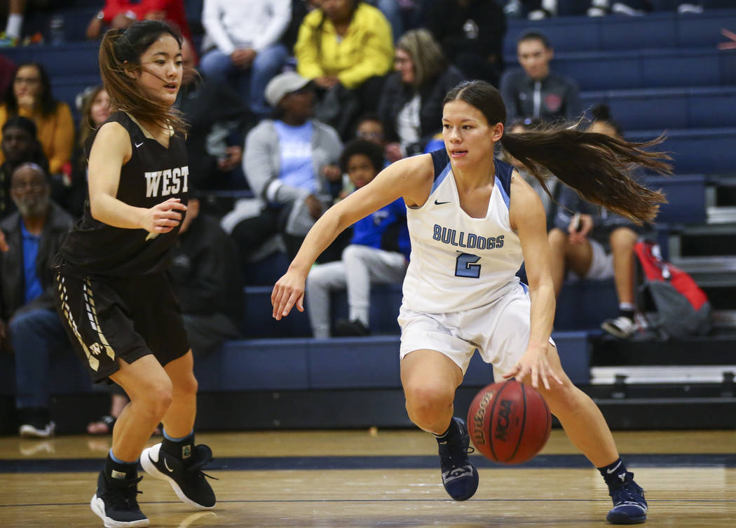 CentennialÕs Melanie Isbell (2) moves the ball around WestÕs Alisa Saito (5) during a basketball game at Centennial High School in Las Vegas on Saturday, Dec. 29, 2018. Chase Stevens Las ...