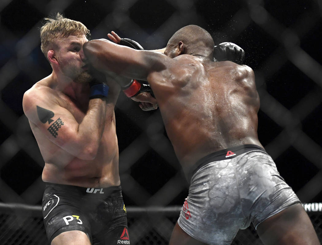 Jon Jones, right, lands an elbow to Alexander Gustafsson during the UFC men's light heavyweight mixed martial arts bout at UFC 232, Saturday, Dec. 29, 2018, in Inglewood, Calif. (AP Photo/Kyusung ...