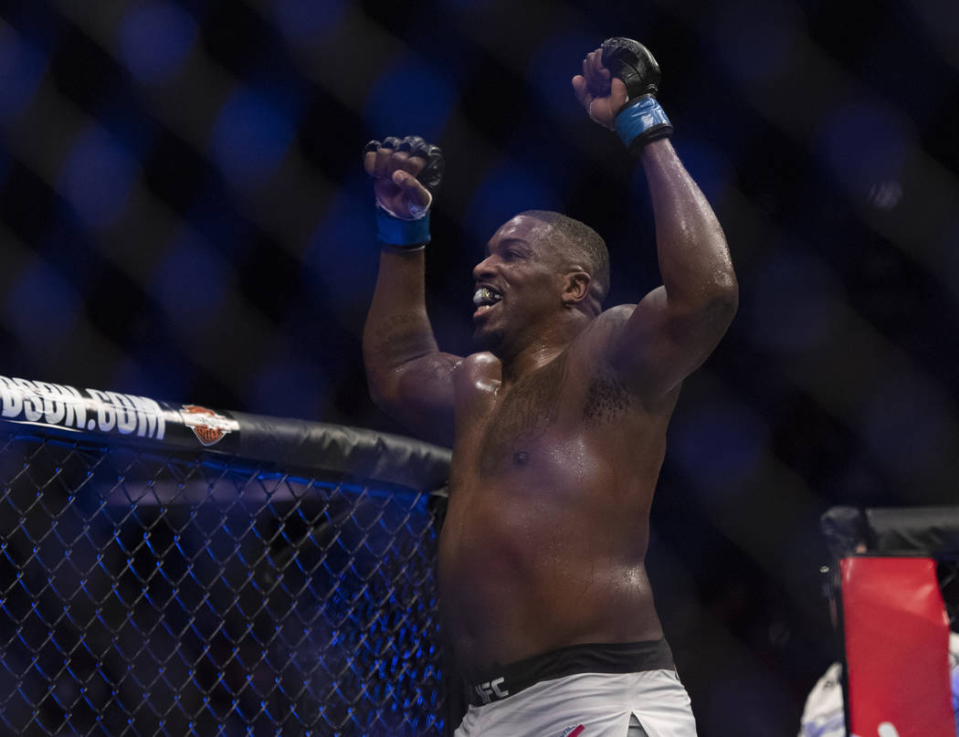 Walt Harris celebrates after defeating Andrei Arlovski in a heavyweight mixed martial arts bout at UFC 232, Saturday, Dec. 29, 2018, in Inglewood, Calif. (AP Photo/Kyusung Gong)