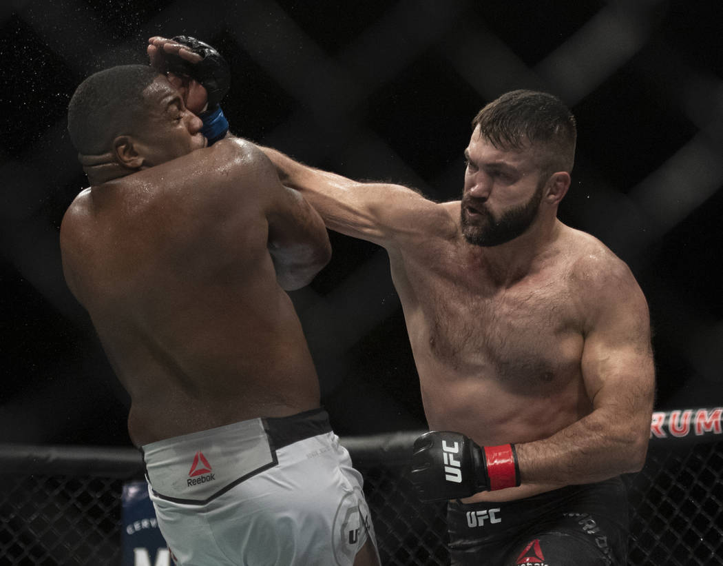 Andrei Arlovski, right, lands a punch on Walt Harris during the third round of a heavyweight mixed martial arts bout at UFC 232, Saturday, Dec. 29, 2018, in Inglewood, Calif. (AP Photo/Kyusung Gong)