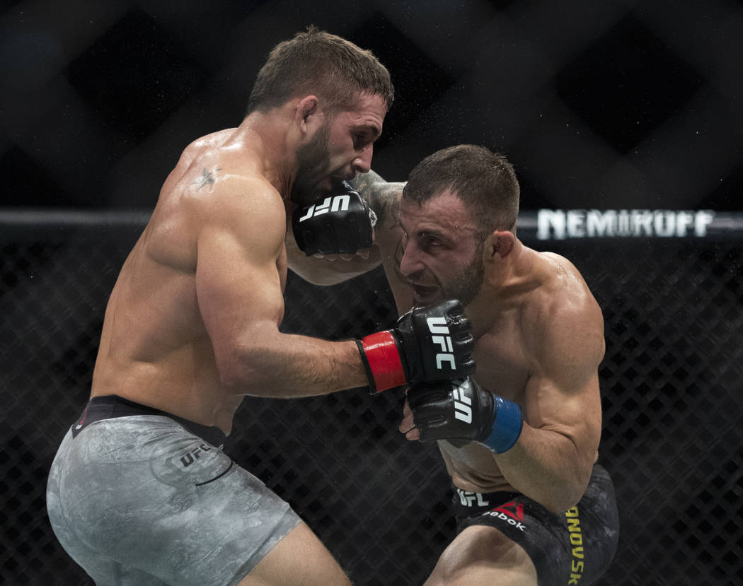 Alexander Volkanovski, right, lands a punch to Chad Mendes during the first round of a featherweight mixed martial arts bout at UFC 232, Saturday, Dec. 29, 2018, in Inglewood, Calif. (AP Photo/Kyu ...