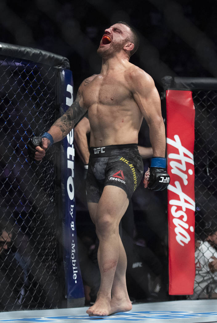 Alexander Volkanovski celebrates after defeating Chad Mendes in a featherweight mixed martial arts bout at UFC 232, Saturday, Dec. 29, 2018, in Inglewood, Calif. (AP Photo/Kyusung Gong)