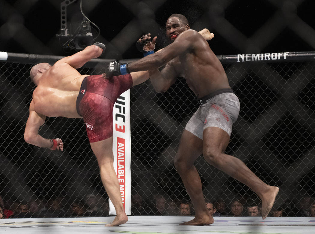 Ilir Latifi, left, lands a kick to Corey Anderson during the third round of a light heavyweight mixed martial arts bout at UFC 232, Saturday, Dec. 29, 2018, in Inglewood, Calif. (AP Photo/Kyusung ...
