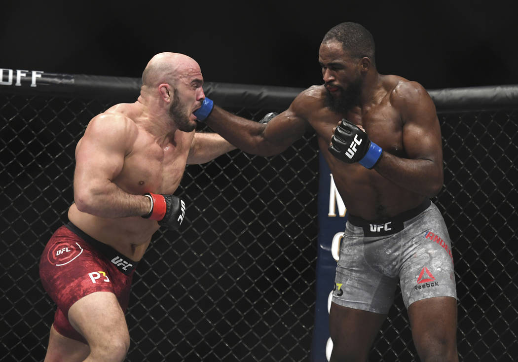 Corey Anderson, right, lands a punch to Ilir Latifi during the second round of a light heavyweight mixed martial arts bout at UFC 232, Saturday, Dec. 29, 2018, in Inglewood, Calif. (AP Photo/Kyusu ...