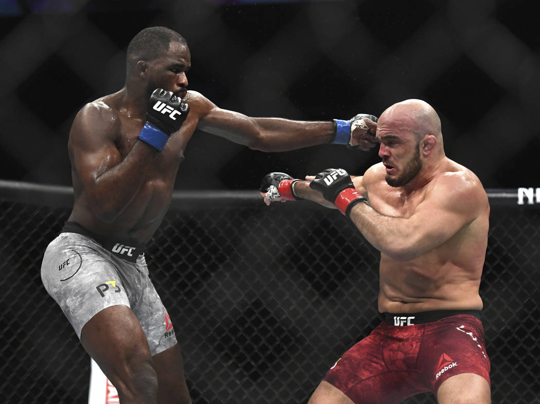 Corey Anderson, left, lands a punch to Ilir Latifi during the first round of a light heavyweight mixed martial arts bout at UFC 232, Saturday, Dec. 29, 2018, in Inglewood, Calif. (AP Photo/Kyusung ...