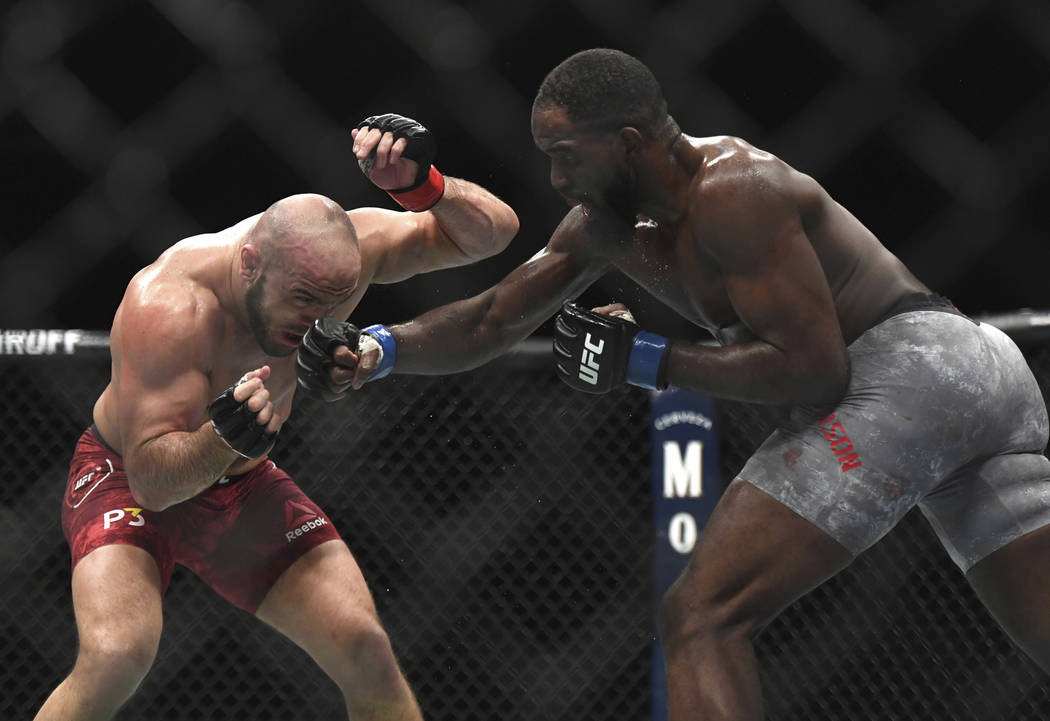 Corey Anderson, right, throws a punch to Ilir Latifi during the third round of a light heavyweight mixed martial arts bout at UFC 232, Saturday, Dec. 29, 2018, in Inglewood, Calif. (AP Photo/Kyusu ...