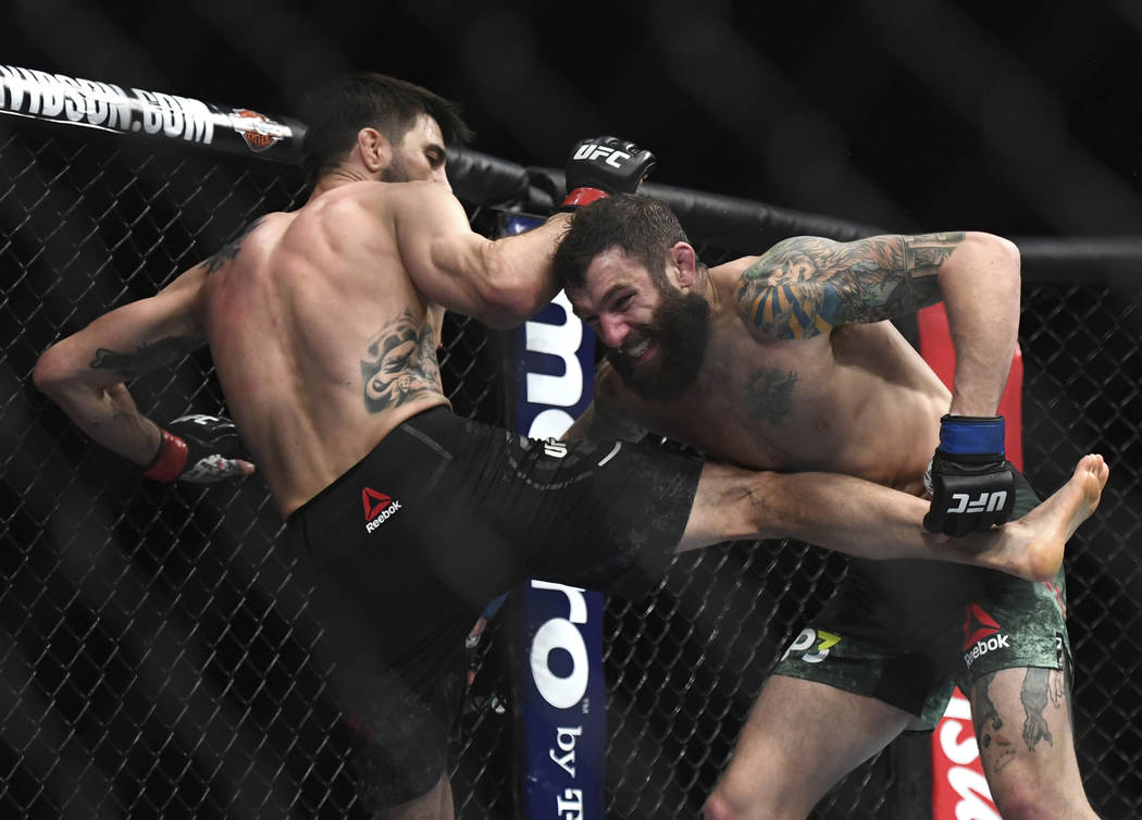 Michael Chiesa, right, tries grab Carlos Condit's leg during the second round of a welterweight mixed martial arts bout at UFC 232, Saturday, Dec. 29, 2018, in Inglewood, Calif. (AP Photo/Kyusung ...