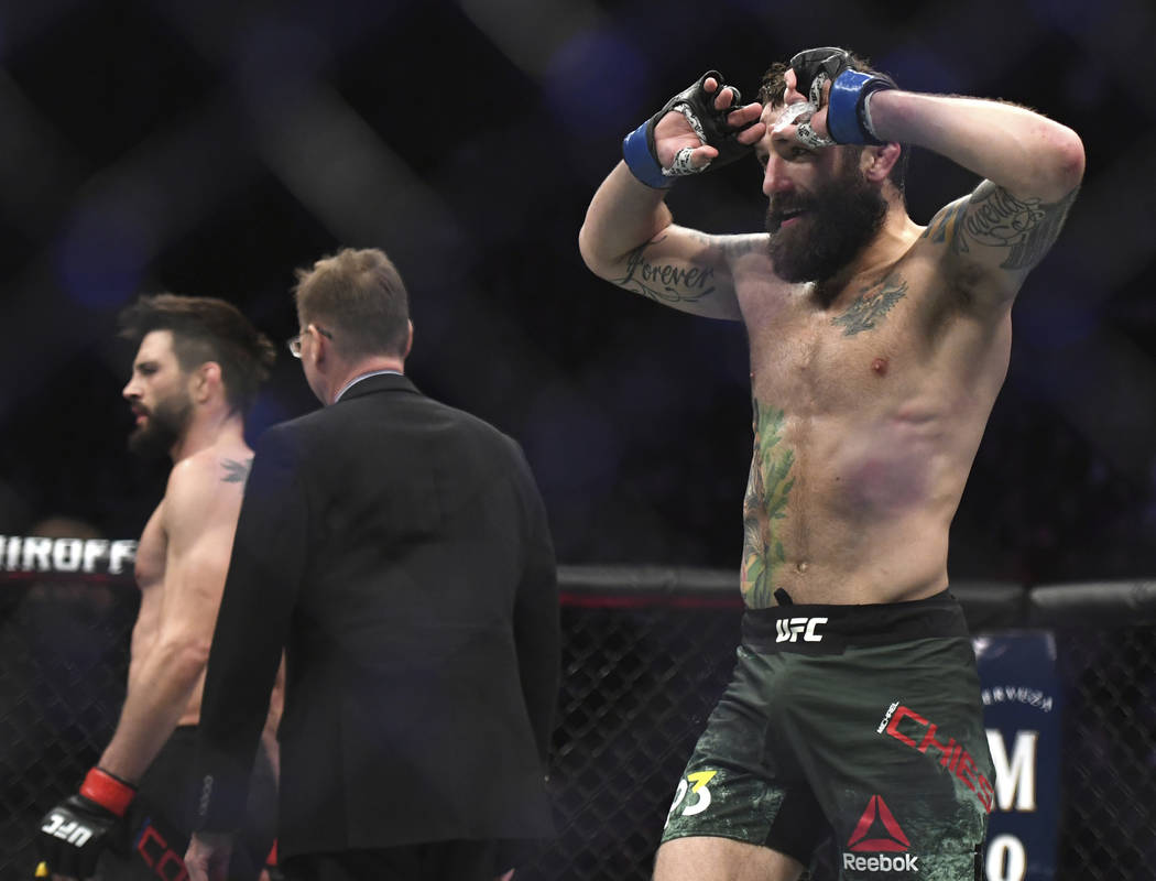 Michael Chiesa, right, celebrates his win over Carlos Condit in a welterweight mixed martial arts bout at UFC 232, Saturday, Dec. 29, 2018, in Inglewood, Calif. (AP Photo/Kyusung Gong)