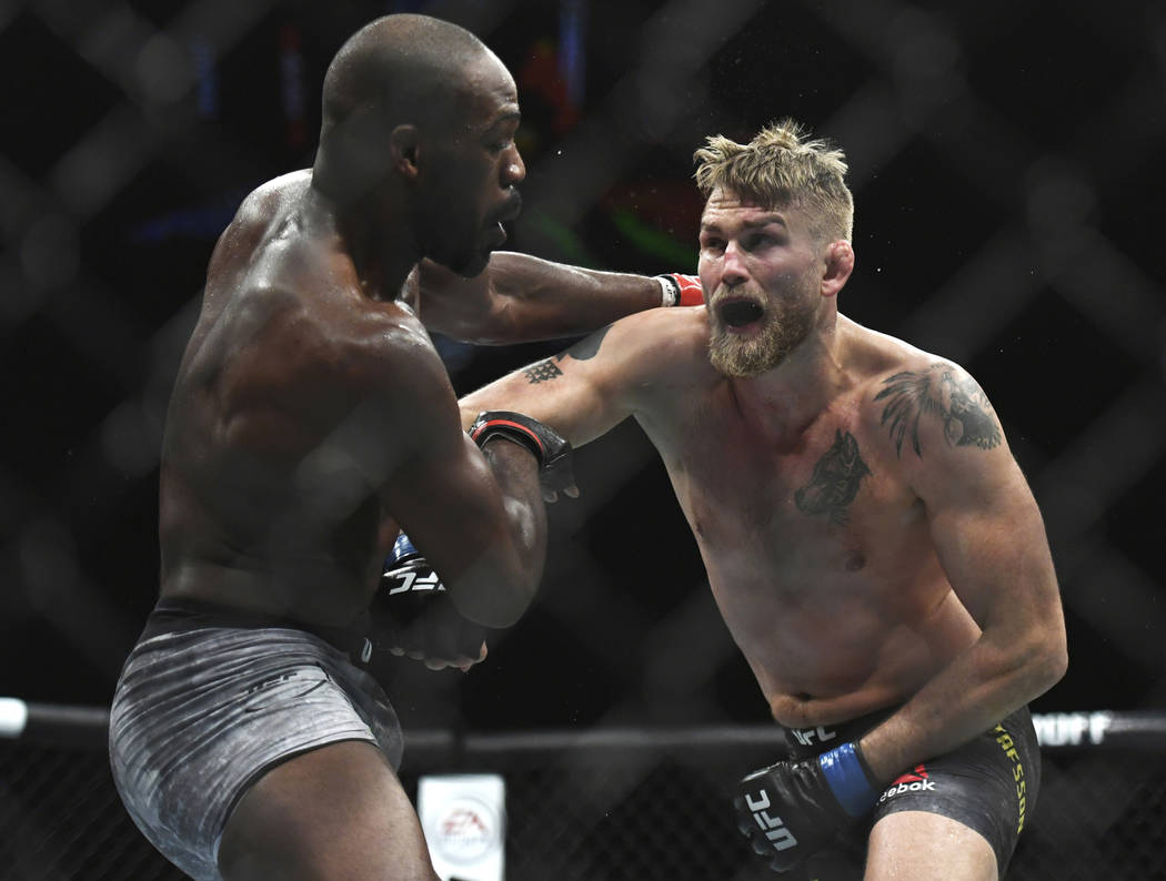 Alexander Gustafsson, right, lands a punch to Jon Jones during the UFC men's light heavyweight title mixed martial arts bout at UFC 232, Saturday, Dec. 29, 2018, in Inglewood, Calif. (AP Photo/Kyu ...