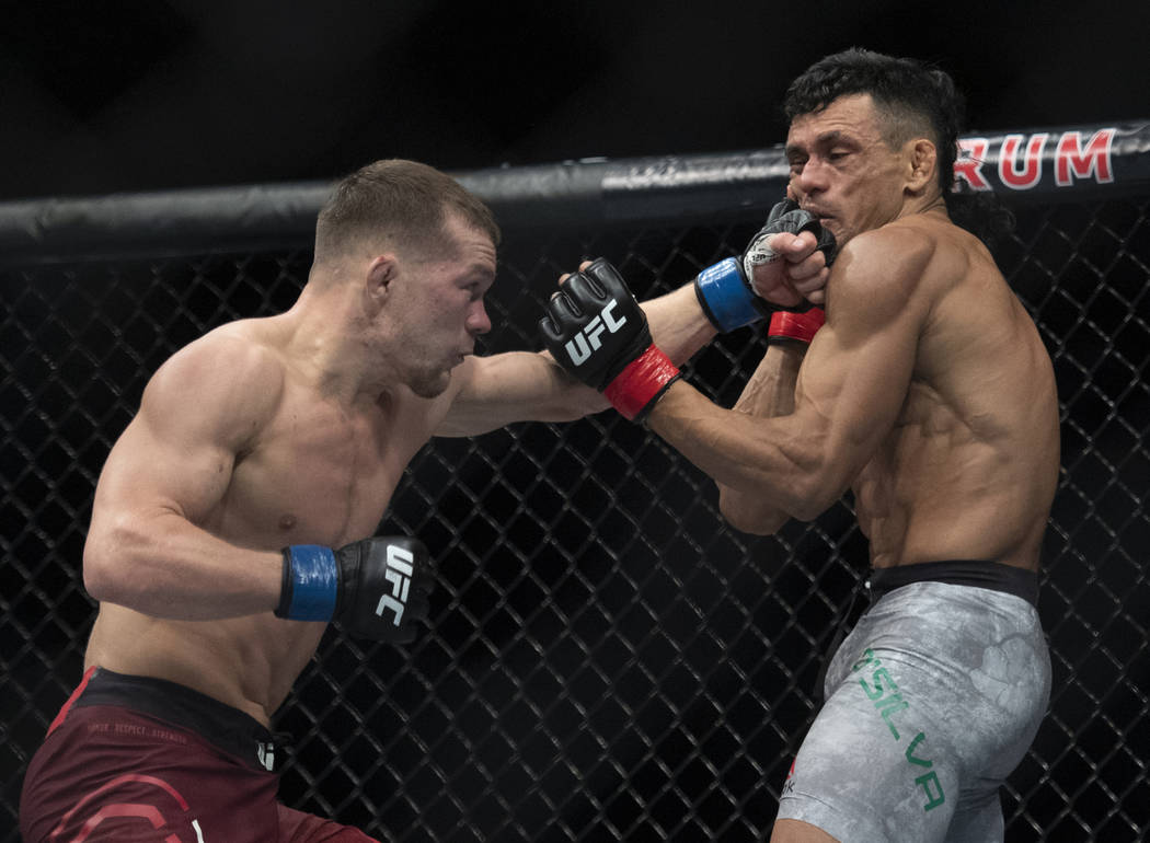 Petr Yan, left, lands a punch to Douglas Silva de Andrade's face during the second round of a bantamweight mixed martial arts bout at UFC 232, Saturday, Dec. 29, 2018, in Inglewood, Calif. (AP Pho ...