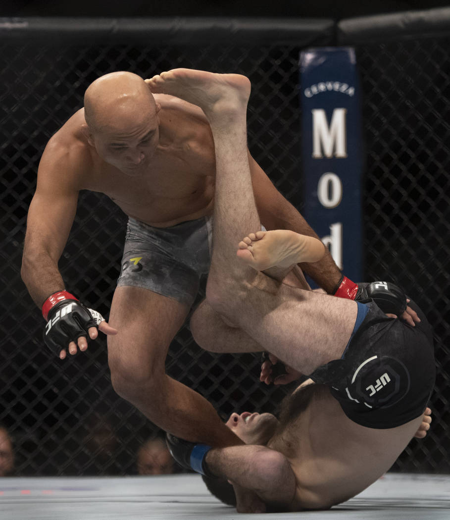 Ryan Hall, bottom, defeats BJ Penn with knee bar during the first round of a lightweight mixed martial arts bout at UFC 232, Saturday, Dec. 29, 2018, in Inglewood, Calif. (AP Photo/Kyusung Gong)