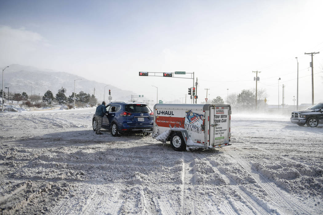 Travelers from California could not make it up the hill near Central Avenue and Tramway Blvd. in Albuquerque Friday December 28, 2018. (Roberto E. Rosales/The Albuquerque Journal via AP)