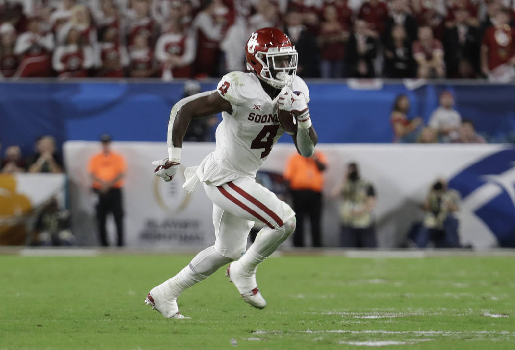 Oklahoma running back Trey Sermon (4) runs the ball, during the first half of the Orange Bowl NCAA college football game against the Alabama, Saturday, Dec. 29, 2018, in Miami Gardens, Fla. (AP Ph ...