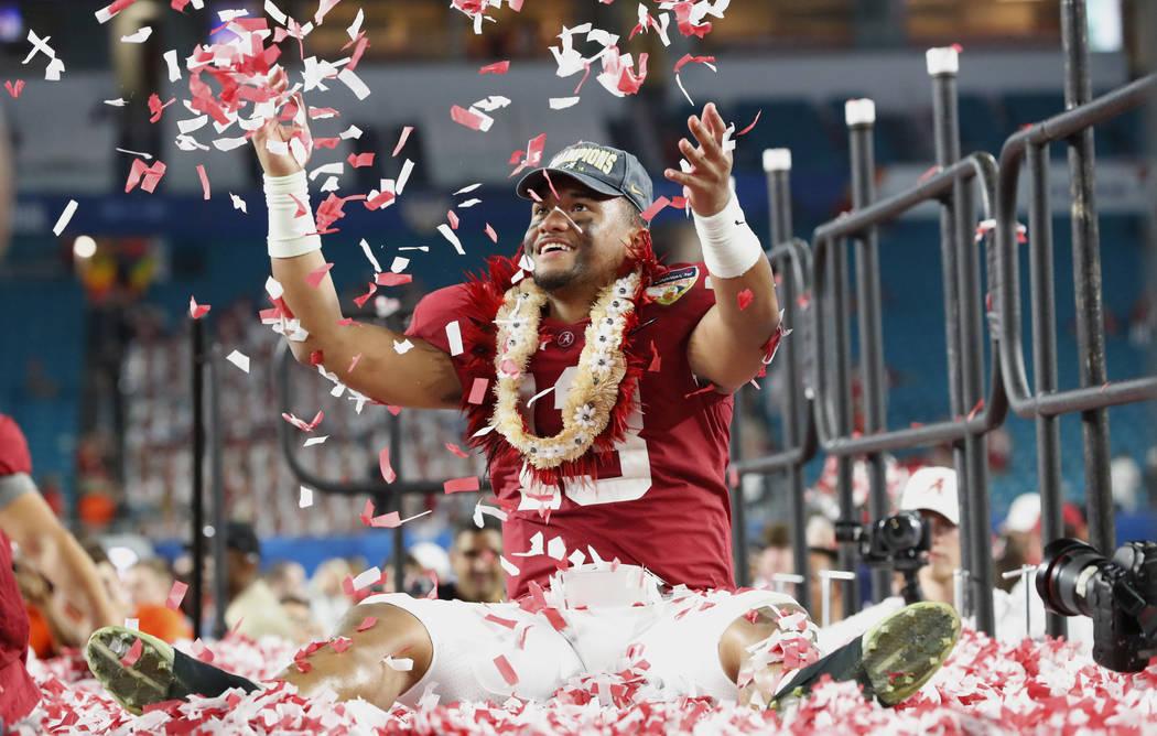 Alabama quarterback Tua Tagovailoa is throws confetti in the air after winning the Orange Bowl NCAA college football game against Oklahoma, Sunday, Dec. 30, 2018, in Miami Gardens, Fla. Alabama de ...