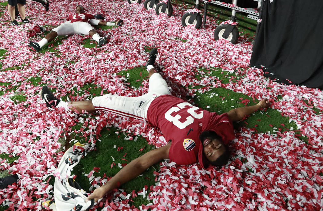Alabama long snapper Ryan Parris (53) plays with the confetti during the Orange Bowl NCAA college football game trophy presentation, Sunday, Dec. 30, 2018, in Miami Gardens, Fla. Alabama defeated ...