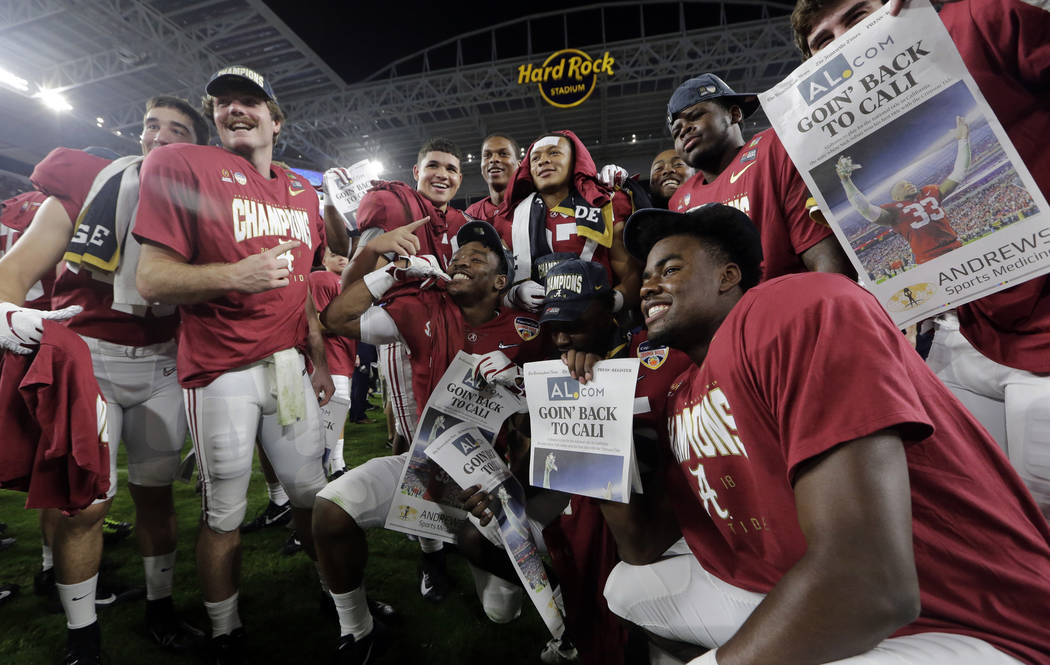 The Alabama team poses on the field at the end of the Orange Bowl NCAA college football game against Oklahoma, Saturday, Dec. 29, 2018, in Miami Gardens, Fla. Alabama defeated Oklahoma 45-34. (AP ...