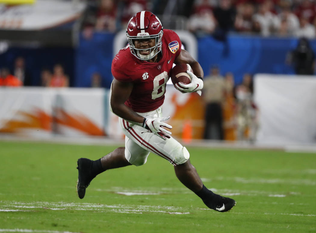 Alabama running back Josh Jacobs (8) runs the ball, during the first half of the Orange Bowl NCAA college football game against Oklahoma, Saturday, Dec. 29, 2018, in Miami Gardens, Fla. (AP Photo/ ...