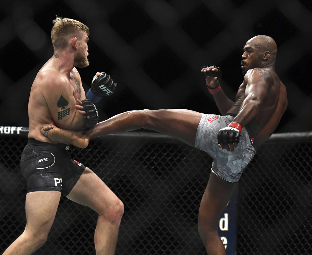 Jon Jones, right, lands a kick to Alexander Gustafsson during the UFC men's light heavyweight mixed martial arts bout at UFC 232, Saturday, Dec. 29, 2018, in Inglewood, Calif. (AP Photo/Kyusung Gong)