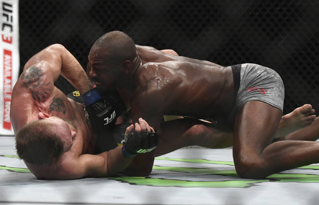 Jon Jones, right, takes Alexander Gustafsson to the ground during the UFC men's light heavyweight mixed martial arts bout at UFC 232, Saturday, Dec. 29, 2018, in Inglewood, Calif. (AP Photo/Kyusun ...